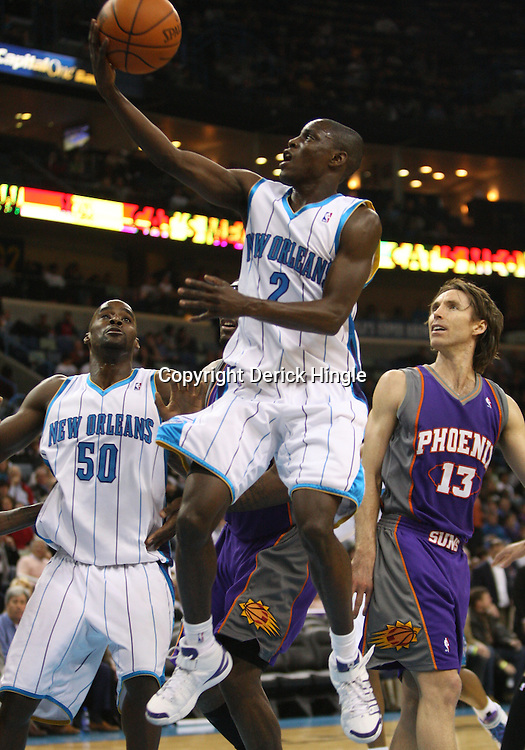 Feb 01, 2010; New Orleans, LA, USA; New Orleans Hornets guard Darren Collison (2) shoots past Phoenix Suns guard Steve Nash (13) during the second half at the New Orleans Arena. Mandatory Credit: Derick E. Hingle-US PRESSWIRE