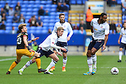 Bradford City striker Billy Clarke (10), Bolton Wanderers midfielder Liam Trotter (17) and Bolton Wanderers midfielder Josh Vela (6) challenge for the ballduring the EFL Sky Bet League 1 match between Bolton Wanderers and Bradford City at the Macron Stadium, Bolton, England on 24 September 2016. Photo by Simon Brady.
