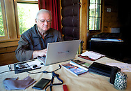 2011-Wisconsin Author Jerry Apps working on his new novel while staying at Hungry Jack Lodge near Grand Marais, Minnesota. Photo Steve Apps.