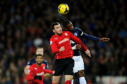 Cardiff Midfielder Jordon Mutch (ENG) and Man Utd Defender Patrice Evra (FRA) compete in the air during the first half of the match - Photo mandatory by-line: Rogan Thomson/JMP - Tel: Mobile: 07966 386802 - 24/11/2013 - SPORT - FOOTBALL - Cardiff City Stadium - Cardiff City v Manchester United - Barclays Premier League.