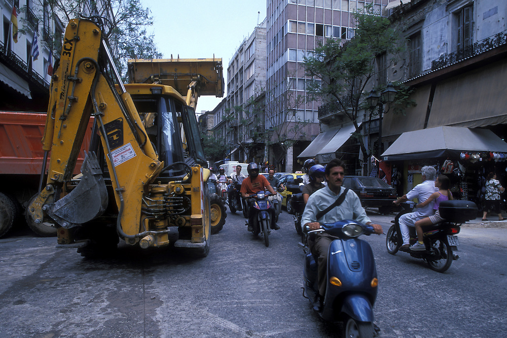 Europe, Greece, Athens, Construction work and equipment blocks crowded downtown street