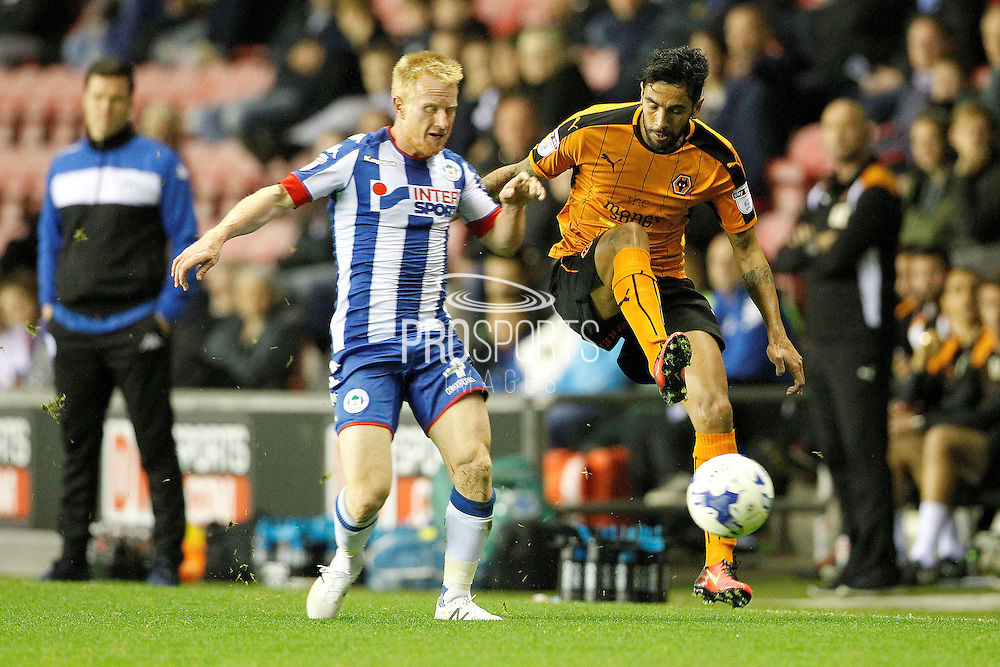 Wigan's David Perkins and Wolves Silvio  during the EFL Sky Bet Championship match between Wigan Athletic and Wolverhampton Wanderers at the DW Stadium, Wigan, England on 27 September 2016. Photo by Craig Galloway.