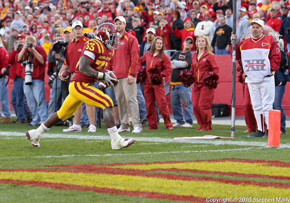 November 06 2010: Iowa State Cyclones running back Alexander Robinson (33) scores a touchdown on a 14 yard run during the second half of the NCAA football game between the Nebraska Cornhuskers and the Iowa State Cyclones at Jack Trice Stadium in Ames, Iowa on Saturday November 6, 2010. Nebraska defeated Iowa State 31-30.