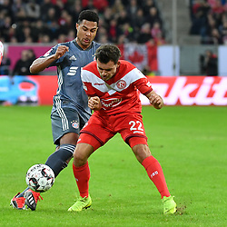 DUESSELDORF, Jan. 13, 2019  Serge Gnabry (L) of Munich vies with Kevin Stoeger of Duesseldorf during the Telecom cup semifinals between Fortuna Duesseldorf and FC Bayern Munich in Duesseldorf, Germany, Jan. 13, 2019. Bayern Munich won 8-7 in penalty shootout. (Credit Image: © Ulrich Hufnagel/Xinhua via ZUMA Wire)