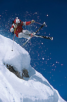 Skier in mid-air above snow on ski Slopes