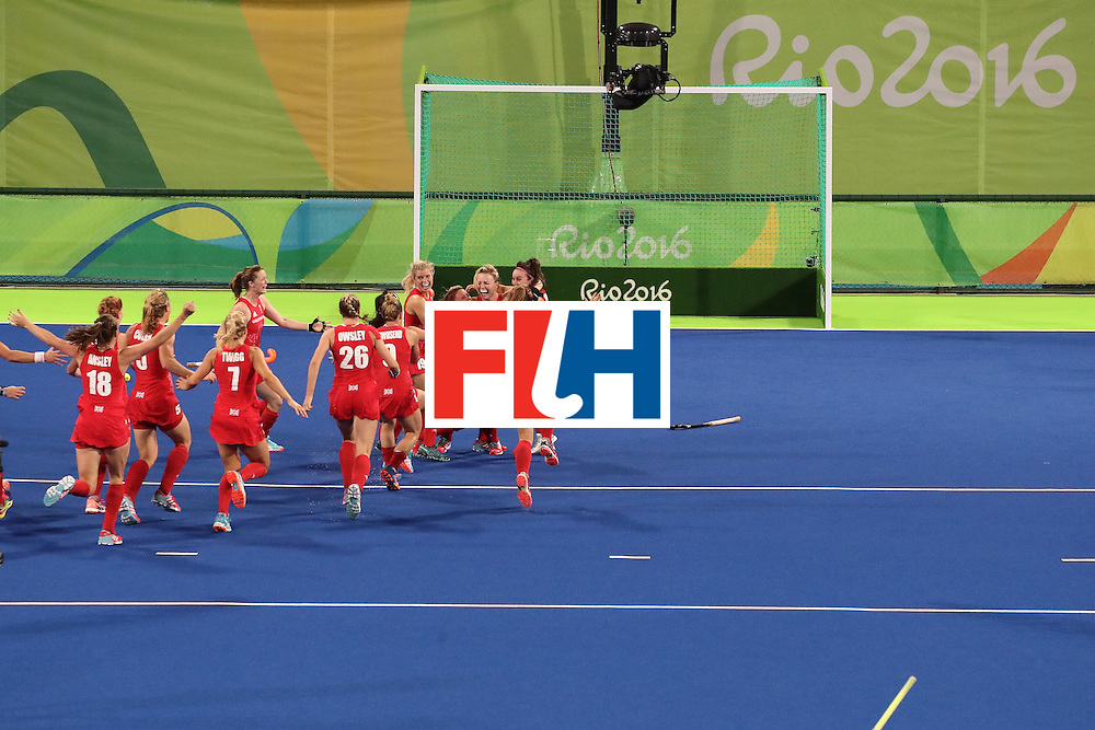 RIO DE JANEIRO, BRAZIL - AUGUST 19:  Hollie Webb of Great Britain celebrates with her team after scoring the winning penalty goal past Joyce Sombroek of Netherlands in the Women's Bronze Medal Match on Day 14 of the Rio 2016 Olympic Games at the Olympic Hockey Centre on August 19, 2016 in Rio de Janeiro, Brazil.  (Photo by Mark Kolbe/Getty Images)