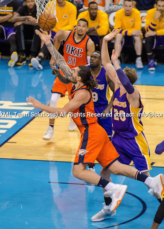 OKLAHOMA CITY, OK - OCTOBER 30:   Oklahoma City Thunder Center Steven Adams (12) lays the ball up versus Los Angeles Lakers. October 30, 2016, at the Chesapeake Energy Arena Oklahoma City, OK. (Photo by Torrey Purvey/Icon Sportswire)