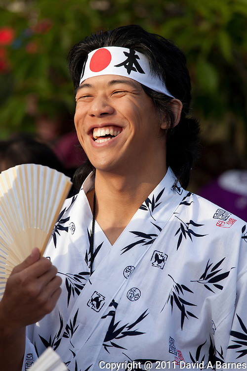 Japanese man in costume smiling broadly