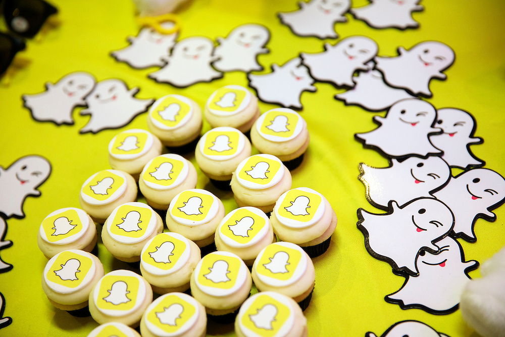 The Snapchat logo is displayed on cupcakes during the TechFair LA job fair in Los Angeles, California, U.S., on Thursday, January 26, 2017. Snap Inc., parent company of the Snapchat app has filed documents for an initial public offering (IPO) with the Securities and Exchange Commission (SEC). © 2017 Patrick T. Fallon