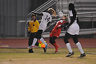 Oxford High' Anna Dennis (14) vs. Lafayette High's Alley Houghton (3) in girls soccer action on Tuesday, December 10, 2013. The match ended in a 5-5 tie.