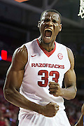 FAYETTEVILLE, AR - NOVEMBER 13:  Moses Kingsley #33 of the Arkansas Razorbacks screams after dunking the ball during a game against the Southern University Jaguars at Bud Walton Arena on November 13, 2015 in Fayetteville, Arkansas.  The Razorbacks defeated the Jaguars 86-68.  (Photo by Wesley Hitt/Getty Images) *** Local Caption *** Moses Kingsley