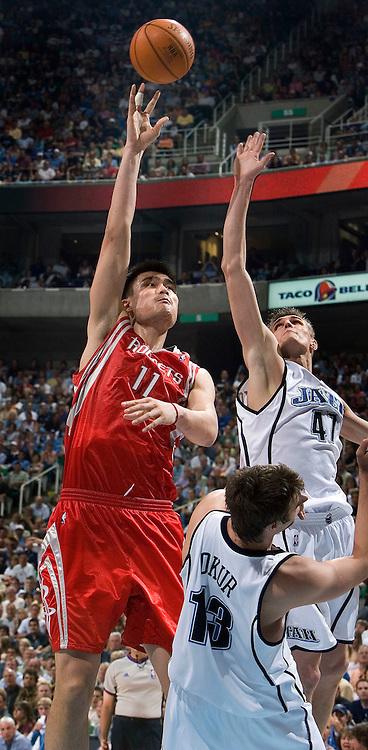 Yao Ming of the Rockets makes a shot over Andrei Kirilenko and Mehment Okur of the Jazz during game 4 of the first round of the playoffs at the Energy Solutions Arena in Salt Lake City, Utah Saturday, April 28, 2007.  August Miller/ Deseret Morning News