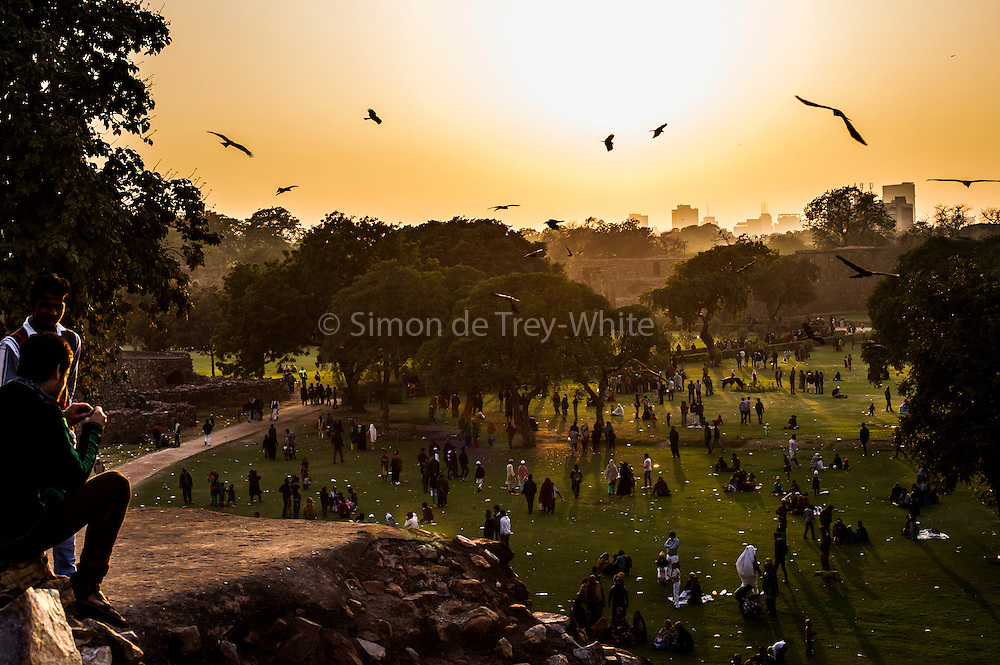 29th January 2015, New Delhi, India. View of the grounds of Feroz Shah Kotla as believers move through them praying, making offerings and asking for their wishes to be granted by Djinns in the ruins of Feroz Shah Kotla in New Delhi, India on the 29th January 2015<br /> <br /> PHOTOGRAPH BY AND COPYRIGHT OF SIMON DE TREY-WHITE a photographer in delhi. + 91 98103 99809. Email:simon@simondetreywhite.com<br /> <br /> People have been coming to Firoz Shah Kotla to leave written notes and offerings for Djinns in the hopes of getting wishes granted since the late 1970's. Jinn, jann or djinn are supernatural creatures in Islamic mythology as well as pre-Islamic Arabian mythology. They are mentioned frequently in the Quran  and other Islamic texts and inhabit an unseen world called Djinnestan. In Islamic theology jinn are said to be creatures with free will, made from smokeless fire by Allah as humans were made of clay, among other things. According to the Quran, jinn have free will, and Iblīs abused this freedom in front of Allah by refusing to bow to Adam when Allah ordered angels and jinn to do so. For disobeying Allah, Iblīs was expelled from Paradise and called &quot;Shayṭān&quot; (Satan).They are usually invisible to humans, but humans do appear clearly to jinn, as they can possess them. Like humans, jinn will also be judged on the Day of Judgment and will be sent to Paradise or Hell according to their deeds. Feroz Shah Tughlaq (r. 1351&ndash;88), the Sultan of Delhi, established the fortified city of Ferozabad in 1354, as the new capital of the Delhi Sultanate, and included in it the site of the present Feroz Shah Kotla. Kotla literally means fortress or citadel.