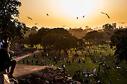 "29th January 2015, New Delhi, India. View of the grounds of Feroz Shah Kotla as believers move through them praying, making offerings and asking for their wishes to be granted by Djinns in the ruins of Feroz Shah Kotla in New Delhi, India on the 29th January 2015<br /> <br /> PHOTOGRAPH BY AND COPYRIGHT OF SIMON DE TREY-WHITE a photographer in delhi. + 91 98103 99809. Email:simon@simondetreywhite.com<br /> <br /> People have been coming to Firoz Shah Kotla to leave written notes and offerings for Djinns in the hopes of getting wishes granted since the late 1970's. Jinn, jann or djinn are supernatural creatures in Islamic mythology as well as pre-Islamic Arabian mythology. They are mentioned frequently in the Quran  and other Islamic texts and inhabit an unseen world called Djinnestan. In Islamic theology jinn are said to be creatures with free will, made from smokeless fire by Allah as humans were made of clay, among other things. According to the Quran, jinn have free will, and Iblīs abused this freedom in front of Allah by refusing to bow to Adam when Allah ordered angels and jinn to do so. For disobeying Allah, Iblīs was expelled from Paradise and called ""Shayṭān"" (Satan).They are usually invisible to humans, but humans do appear clearly to jinn, as they can possess them. Like humans, jinn will also be judged on the Day of Judgment and will be sent to Paradise or Hell according to their deeds. Feroz Shah Tughlaq (r. 1351–88), the Sultan of Delhi, established the fortified city of Ferozabad in 1354, as the new capital of the Delhi Sultanate, and included in it the site of the present Feroz Shah Kotla. Kotla literally means fortress or citadel."