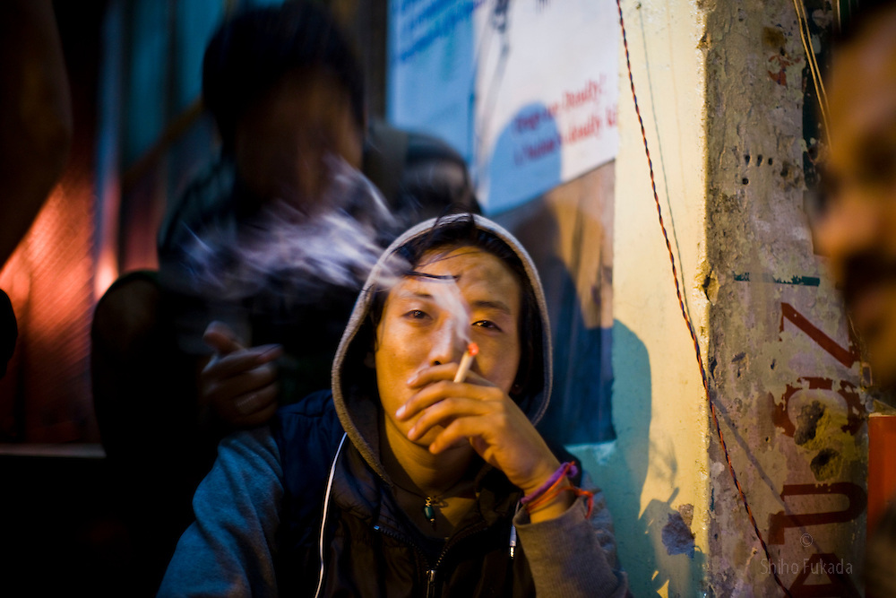 Young Tibetans pass time in town of McLeod Ganj, Dharamsala, India, where the Dalai Lama settled after fleeing Tibet in 1959 after a failed uprising against Chinese rule, May 30, 2009.