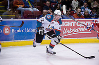 KELOWNA, CANADA, DECEMBER 27: Mackenzie Johnston #22 of the Kelowna Rockets skates with the puck against the Spokane Chiefs at the Kelowna Rockets on December 7, 2011 at Prospera Place in Kelowna, British Columbia, Canada (Photo by Marissa Baecker/Getty Images) *** Local Caption ***