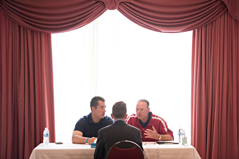 During evaluations, Minor League Umpire John Libka, left, and Major League Umpire Ed Hickox, meet with Brandon Blome, the Top Student from the 2016 Wendelstedt Umpire School class.