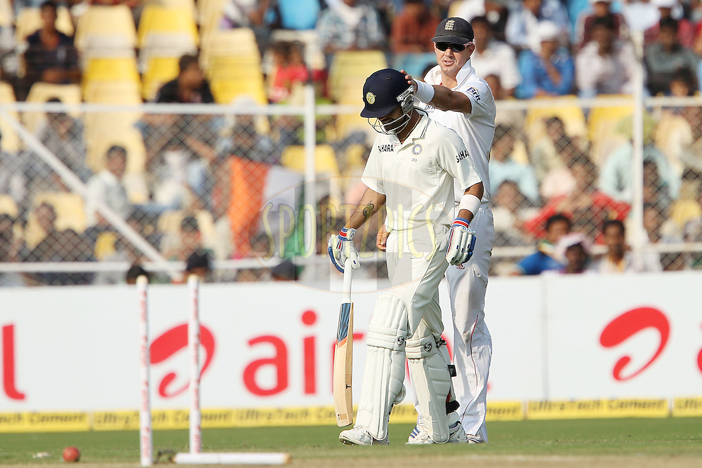 Kevin Pietersen of England taps Virat Kohli of India on the helmet after a near run out during day one of the 1st Airtel Test Match between India and England held at the Sadar Patel Stadium in Ahmedabad, Gujarat, India on the 15th November 2012...Photo by Ron Gaunt/ BCCI/ SPORTZPICS..Use of this image is subject to the terms and conditions as outlined by the BCCI. These terms can be found by following this link:.http://sportzpics.photoshelter.com/gallery-image/Cricket-India-v-England-Media-Images/G0000AUI2llzp5hI/I0000oeIszLukZJ8/C0000b7t75hxE_a4