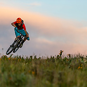 Andrew Whiteford gets a little air just after sunset on Munger Mountain near Wilson, Wyoming.