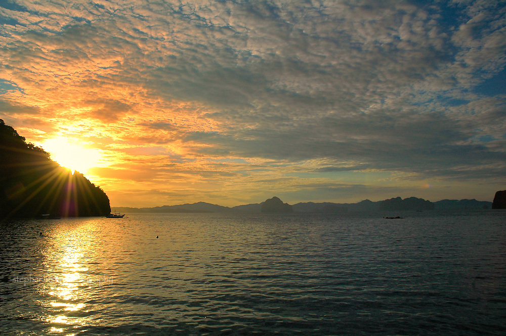 Sunrise at El Nido Resort, Miniloc Islands, Palawan, The Philippines, over the South China Sea.