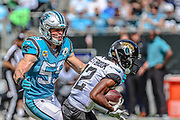 Sunday, October 6, 2019; Charlotte, N.C., USA;  Jacksonville Jaguars wide receiver Dede Westbrook (12) runs with the ball while Carolina Panthers linebacker Brian Burns (53) prepares to tackle during an NFL game at Bank of America Stadium. The Carolina Panthers beat the Jacksonville Jaguars 34-27. (Brian Villanueva/Image of Sport)