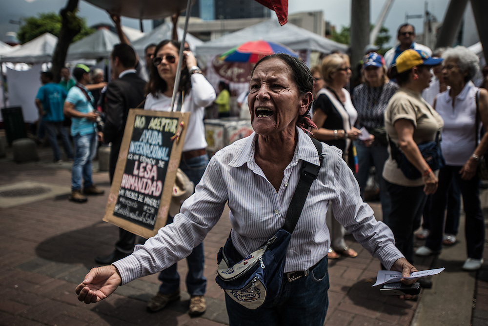 "CARACAS, VENEZUELA - APRIL 13, 2016:  Isabel Sanchez, 68, shouts in protest with doctors, patients and their families while blocking traffic during a protest against the hospital crisis. ""I am here protesting to defend my country, because we are in a crisis,"" Ms. Sanchez said.  ""Venezuelans have to get out in the streets, tell the truth, and defend our human right of access to healthcare.""  Despite having the largest oil reserves in the world, falling oil prices and wide-spread government corruption have pushed Venezuela into an economic crisis, with the highest inflation in the world and chronic shortages of food and medical supplies.  PHOTO: Meridith Kohut for The New York Times"