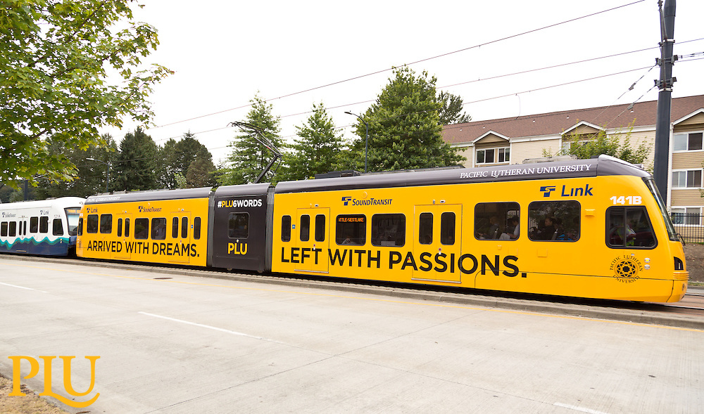 Sound Transit light rail the Link wrapped in plu six (6) word stories seen on Thursday, Aug. 28, 2014. (Photo/John Froschauer)
