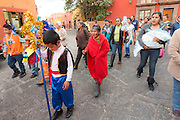 A procession of children lead the Three Kings through the cobble streets during El Dia de Reyes January 6, 2016 in San Miguel de Allende, Mexico. The traditional festival marks the culmination of the twelve days of Christmas and commemorates the three wise men who traveled from afar, bearing gifts for the infant baby Jesus.