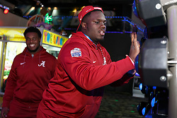 The Alabama Crimson Tide play games and ride go-carts at Andretti Indoor Karting & Games on December 26, 2016 in Atlanta. Alabama faces the Washington Huskies in the 2016 Chick-fil-A Peach Bowl Playoff Semifinal on New Year's Eve, with the winner advancing to the National Championship. (Paul Abell / Abell Images for the Chick-fil-A Peach Bowl)