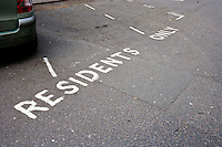 Close-Up of road marking saying Residents Parking Only in London, UK