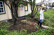 Lower 9th Ward resident Rosetta S. Allen, 80 years old, works alone in her yard and house attempting to rebuild one year after Hurricane Katrina. She is a 56 year resident and original owner of her house and just remodeled before Katrina struck.