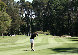 (Canberra, Australia---30 January 2011)  A player hits down to the green during the final round of the ActewAgl Royal Canberra Ladies golf tournament as part of the 2011 Australian Ladies Pro Golf Tour./ 2011 Copyright Sean Burges. For Australian editorial sales, contact seanburges@yahoo.com.