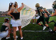 11 SEPT. 2009 -- ST. LOUIS -- Lindbergh High School players rush onto the field following the playing of the National Anthem before the start of the game between the Flyers and Oakville High School Friday, Sept. 11, 2009. Lindbergh led Oakville 14-0 at halftime on a pair of touchdowns by running back Eric Schwartz.  Photo © copyright 2009 by Sid Hastings.