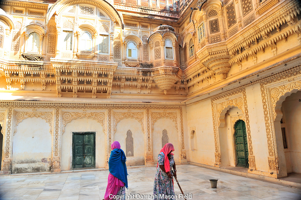 Cleaner mops a marble courtyard Mehrangarh Fort