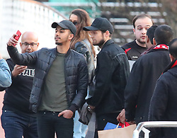 The Manchester United team arrive at The Lowry Hotel on Saturday evening to prepare for their home game against West Brom on Sunday afternoon. Seen: Daley Blind who is not in the squad walked past The Lowry with his fiance and walked into Manchester city centre.