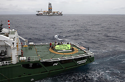 "ATLANTIC OCEAN 9NOV14 - Activists aboard the Greenpeace ship Esperanza protest against the Rowan Reniassance drill ship in the Atlantic ocean. The banner on the side of the Esperanza reads ""Repsol - Prospecciones No!"", opposing drilling operations off the Canary Islands by Spanish oil company Repsol.<br /> <br /> jre/Photo by Jiri Rezac / Greenpeace<br /> <br /> © Jiri Rezac 2014"