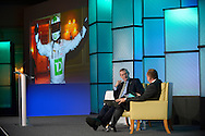 TD Bank President & CEO W. Edmund Clark, left, answers questions to the TD Bank Auto Finance Conference in Miami, Fla. (Photo by Phelan M. Ebenhack/for TD Bank)