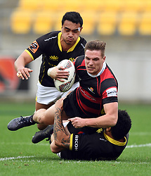 Canterbury's George Bridge taken in a Wellington tackle in the Mitre 10 Rugby match at Westpac Stadium, Wellington, New Zealand, Sunday September 17,, 2017. Credit:SNPA / Ross Setford  **NO ARCHIVING**