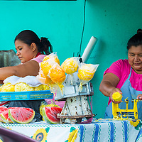 PANCHIMALCO , EL SALVADOR - MAY 08 : A Salvadorian women sells fruits during the Flower & Palm Festival in Panchimalco, El Salvador on May 08 2016