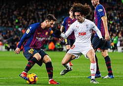 BARCELONA, Jan. 14, 2019  SP)SPAIN-BARCELONA-SOCCER-LA LIGA-BARCELONA VS EIBAR.    Barcelona's Lionel Messi (L) vies with Eibar's Marc Cucurella.    during a Spanish league match between FC Barcelona and SD Eibar in Barcelona, Spain, on Jan. 13, 2019. FC Barcelona won 3-0. (Credit Image: © Joan Gosa/Xinhua via ZUMA Wire)