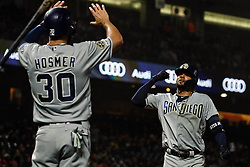 SAN FRANCISCO, CA - APRIL 08: Fernando Tatis Jr. #23 of the San Diego Padres is congratulated by Eric Hosmer #30 after hitting a two run home run against the San Francisco Giants during the fifth inning at Oracle Park on April 8, 2019 in San Francisco, California. The San Diego Padres defeated the San Francisco Giants 6-5. (Photo by Jason O. Watson/Getty Images) *** Local Caption *** Fernando Tatis Jr.; Eric Hosmer