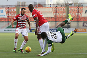 Glasgow Celtic forward Odsonne Edouard (22) is up ended by Hamilton Academical defender Delphin Tshiembe (5) during the Ladbrokes Scottish Premiership match between Hamilton Academical FC and Celtic at New Douglas Park, Hamilton, Scotland on 24 November 2018. Pic Mick Atkins