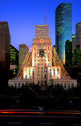 Stock photo of Houston,Texas City Hall with Wells Fargo Plaza in background at dusk.