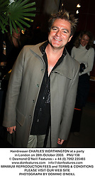Hairdresser CHARLES WORTHINGTON at a party in London on 28th October 2003.PNU 138