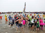 Participants enter Lake Ontario at the 14th Annual Polar Bear Plunge at Ontario Beach Park on Sunday, February 9, 2014.