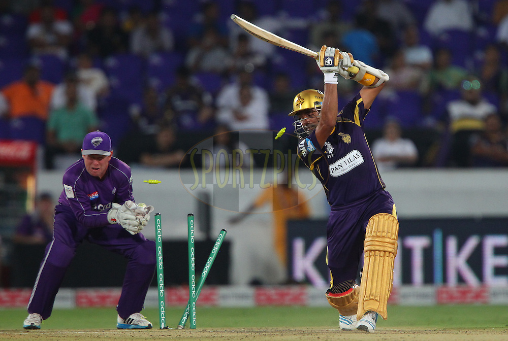 Robin UTHAPPA of the Kolkata Knight Riders is bowled by Xavier DOHERTY of the Hobart Hurricanes  during the first semi final match of the Oppo Champions League Twenty20 between the Kolkata Knight Riders and the Hobart Hurricanes held at the Rajiv Gandhi Cricket Stadium, Hyderabad, India on the 2nd October 2014<br /> <br /> Photo by:  Ron Gaunt / Sportzpics/ CLT20<br /> <br /> <br /> Image use is subject to the terms and conditions as laid out by the BCCI/ CLT20.  The terms and conditions can be downloaded here:<br /> <br /> http://sportzpics.photoshelter.com/gallery/CLT20-Image-Terms-and-Conditions-2014/G0000IfNJn535VPU/C0000QhhKadWcjYs