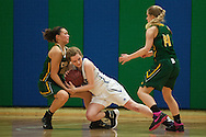 BFA's Hannah Earl (10) and Colchester's Jenny Thompson (15) battle for the loose ball as BFA's Sarah Newhall (14) looks on during the girls basketball playoff game between the BFA St. Albans Bobwhites and the Colchester Lakers at Colchester high school on Tuesday night February 23, 2016 in Colchester. (BRIAN JENKINS/for the FREE PRESS)