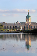 Schloss Charlottenburg or Charlottenburg Palace, built 1695-1713 by Johann Arnold Nering in Baroque and Rococo style, seen from across the lake, Charlottenburg, Charlottenburg-Wilmersdorf, Berlin, Germany. The original palace was commissioned by Sophie Charlotte, the wife of Friedrich III, Elector of Brandenburg and later Friedrich I of Prussia. Prussian rulers occupied the palace until the late 19th century. After being badly damaged in the war, the palace was restored and is now a major tourist attraction. Picture by Manuel Cohen