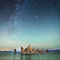 This is one of those happy accident, luck shots.  While taking some long eposures of the mineral island in Mono Lake, two hikers happened to light the island with their headlamps as they made their way down to the water's edge. I believe that is the Andromeda Galaxy in the top third of the image.  © John McBrayer