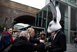© Licensed to London News Pictures. 22/03/2013. London, UK A vendor dressed like rabbit sells chocolate during the three-day-long The Chocolate Festival at the Southbank Centre. . The Chocolate Festival returns to Southbank Centre in London for the 10th time. the festival runs from 22-24th March 2013. Photo credit : Peter Kollanyi/LNP